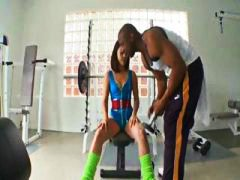 Brunette girl gets her honeypot and booty worked by a fat ebony hard-on in the gym