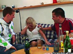 Inebriated blonde granny in steaming three-way orgy