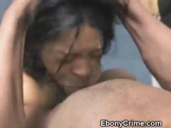 Ebony ghetto tramp on her knees getting her throat ruined