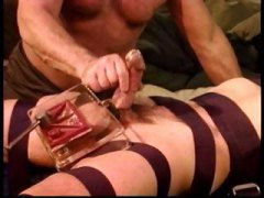 I crush a youthful super dangled men meaty nut sack in a vise as a masturbate him off.