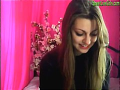 Brunette teenage playing with a pinkish dildo1.wmv