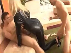 Honey in a ebony leather catsuit poked insome