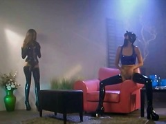 Wild lesbo slut in a gas mask and latex poses and dances
