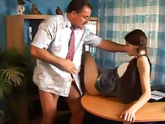 Teenage student in pigtails pumelled by teacher