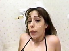 Female wearing toilet set gets mistreated by guy in bathroom