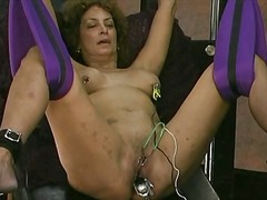 Mature whore in a daring restrain bondage spectacle