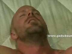 Gagged stud has his boner gargled on a iron bed against his fantasy by a predominant gay dude