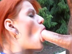 Redhead gets toyed as she deep throats and gets banged from behind with a sloppy facial