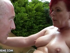 Naughty granny slyt with crimson tresses bumped outdoor