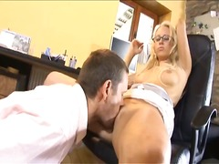 This torrid blonde secretary is nasty and willing to take on his rock hard instrument