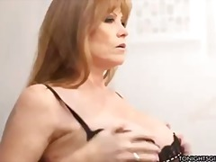 Darla crane wears fantastic thong and shows off her massive breasts for her client