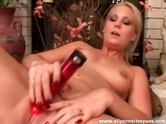 Voluptuous blonde minx with pointy melons pummeling crimson fake penis