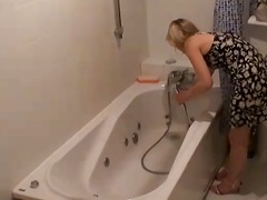 Bathroom hidden camera filming the torrid blonde marina getting willing for an erotic bathtub