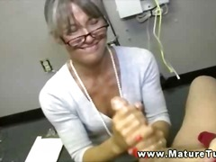 Mature doctor on her knees masturbating off masculine