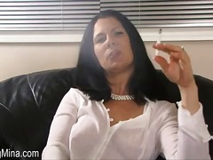 Hotty in a white blouse smokes