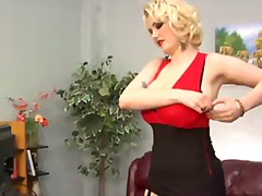 Siri is s curvaceous blond-haired domina