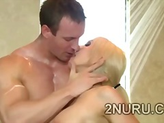 Fat stacked blondie seduces hunky perv in the shower