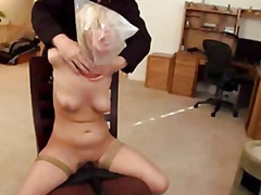 Tied to chair blonde gets stimulated until finishes off