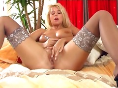 Nymph close by oustanding drizzle inwards pantyhose fingers her coochie