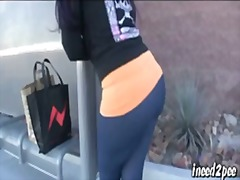 Caroline pierce wetting spandex leggings outside in public