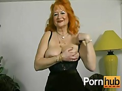Crimson-headed german granny shows off for the camera
