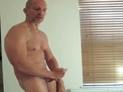 Bulky mature man draining off