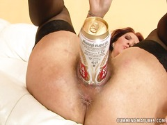A promiscuous stunner uses a can of beer to pack her greedy super hot beaver