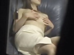Spy cam caughts on gauze asian wide groping her bosoms