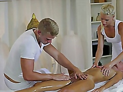 Steamy brunette in three way with masseurs couple